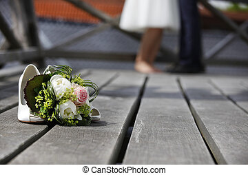 Bridal bouquet lying on the floor - Bride with bridal...