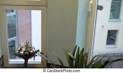 Bridal bouquet near window in room