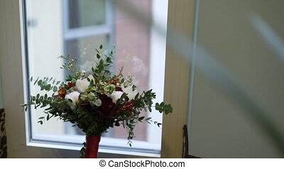 Bridal bouquet near window in room
