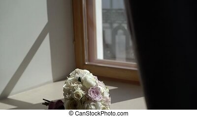 Bridal bouquet near window - Bridal bouquet with roses near...
