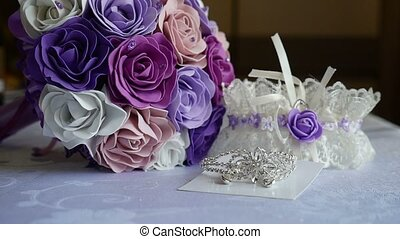 bridal bouquet of blue, purple video and white roses on a table