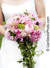 Bridal Bouquet of flowers - A bride is holding her beautiful...