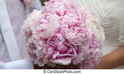 Bridal bouquet of peonies.