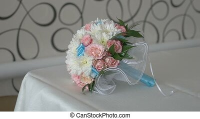 bridal bouquet of white roses and blue colors in lace video...