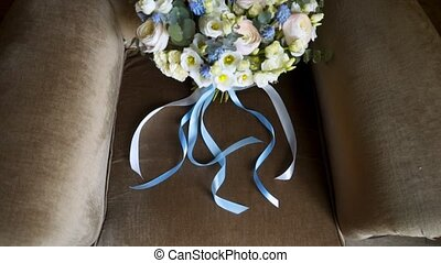 Bridal bouquet on a chair - Bridal bouquet flowers on a...