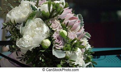 Bridal bouquet on a hood of blue retro bus - Bridal bouquet...