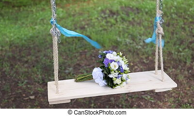 Bridal bouquet on a swing