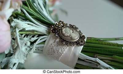 Bridal bouquet on bed in room