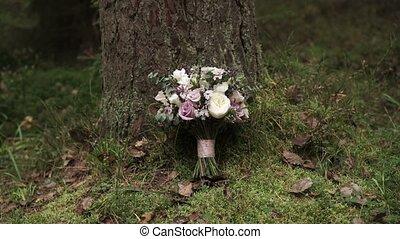Bridal bouquet outdoors pan shot