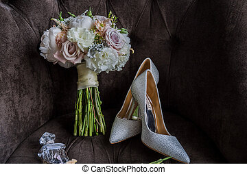 bridal bouquet with shoes on the chair