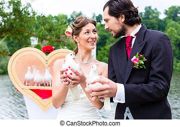 Bridal couple at wedding with white doves