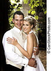 Bridal Couple - Beautiful bridal couple outdoors on their...