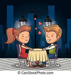 bridal couple having dinner on the street at night