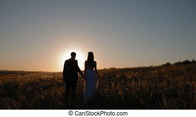 Bridal couple in sunset sun