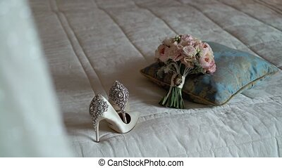 Bridal dress, bouquet and shoes
