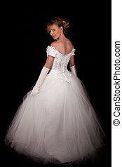 Bridal gown - Full body of an attractive blond woman wearing...