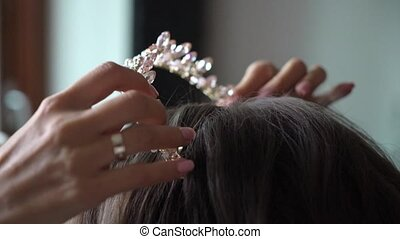 Bridal make up and hairstyle. Royal crown with crystals and...