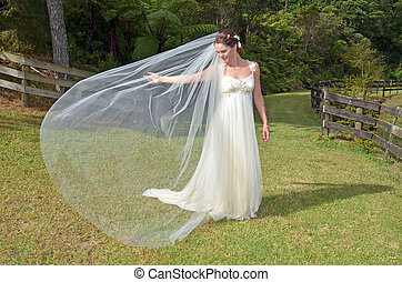 Bridal play with her veil outdoor on her Wedding Day