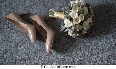 Bridal shoes and bouquet composition