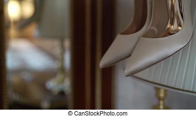 Bridal shoes at lamp