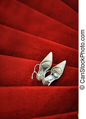 Bridal Shoes - White bridal shoes on red carpet