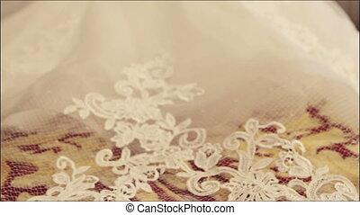 Bridal veil. Plume of wedding dress. Wedding ceremony.