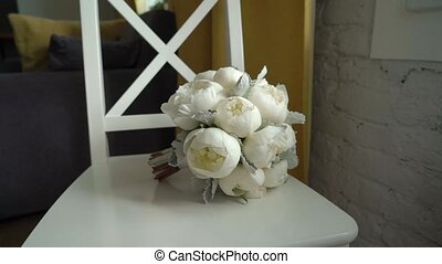 Bridal wedding bouquet with white peonies