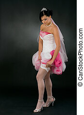 Bride adjusting stockings - Beautiful young bride in tied up...