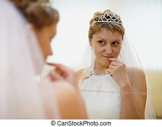 Bride admires himself in mirror
