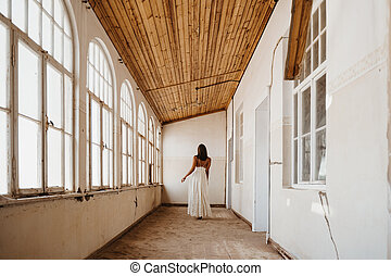 bride after getting ready standing in an abandoned old building