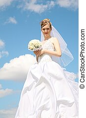 bride against the background of the sky