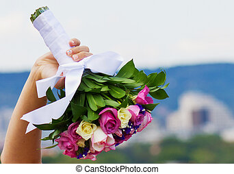 Bride and bouquet. Wedding Bouquet. Bouquet in the hands of the bride. Bride holding a wedding bouquet.