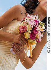 Bride and bouquet. Wedding Bouquet. Bouquet in the hands of the bride. Bride holding a wedding bouquet.