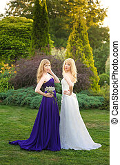 Bride and bridesmaid outside
