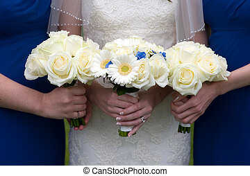 bride and bridesmaids with wedding bouquets