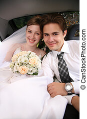 bride and fiance in the car