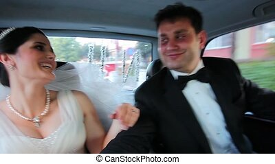 bride and groom have a fun in the car