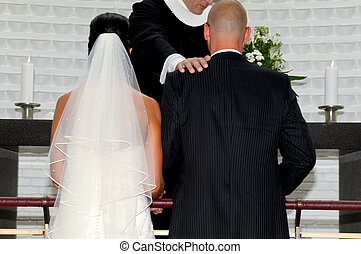 Bride and groom and prist