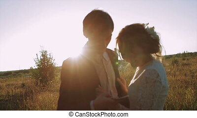Bride And Groom at Sunset Using Smartphone