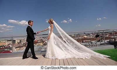 Bride and groom at the roof
