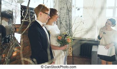 Bride and groom at wedding ceremony. Fun case after registrar speech
