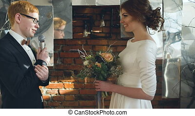 Bride and groom at wedding ceremony talk oath to each other . Bride have tears of happy