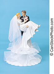 Bride and groom cake topper on blue background