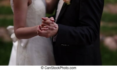 bride and groom dance outdoors in the park. - bride and...