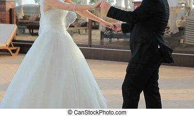 Bride and groom dancing on a summer area