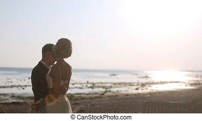 Bride and groom dancing outdoors