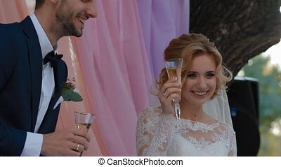 Bride and groom drink champagne
