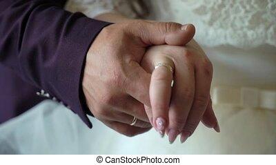 Bride and groom embracing. Newlyweds hug and holding hands...