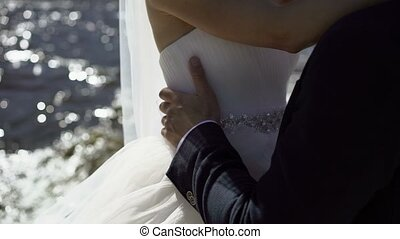 Bride and groom embracing on motorboat