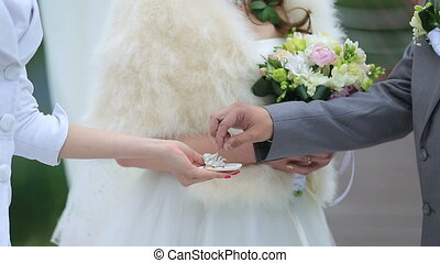 Bride and groom exchanging rings on the wedding ceremony.